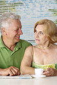 Handsome old couple at the resort — Stock Photo