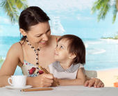 Pretty woman with daughter at the resort — Stock Photo