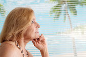 Dreaming woman at the resort — Stock Photo