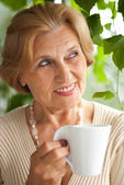Good-looking older woman resting — Stock Photo