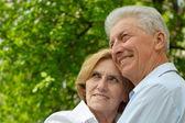 Smiling couple enjoy union with nature — Stock Photo