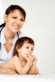 Glorious physician with small patient — Stock Photo