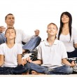 Family doing yoga — Stock Photo
