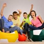 Happy family watching tv — Stock Photo #31208237