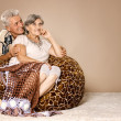 Happy beautiful elderly couple relaxing at home — Stock Photo #31209297