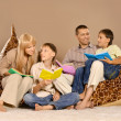 Happy family reading — Stockfoto