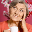 Elderly woman with cup — Stock Photo