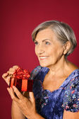 Elderly woman get a gift — Stock Photo