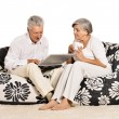 Elderly couple resting at home — Stock Photo