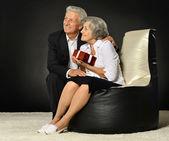 Elderly couple celebrating holiday — Stock Photo