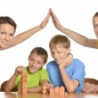 Family playing at home — Stock Photo #32065575