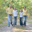 Happy family in the birch forest — Stock Photo #32065747