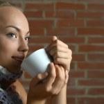 Teenage girl drinking tea — Stock Photo