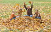 Grandparents with kids in park — Stock Photo