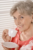 Senior woman with cup — Stock Photo