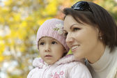 Mother with daughter at nature — Stock Photo