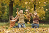 Mother with two sons in autumn park — Stock Photo