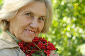 Old woman with a mountain — Stock Photo