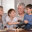 Stock Photo: Happy family at lotto