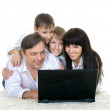 Family  resting a laptop — Stock Photo