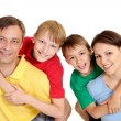Sympothetic family in bright T-shirts — Stock Photo