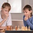 Stock Photo: Two boys playing chess