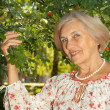 Pretty elderly woman in the garden — Stock Photo