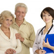 Young nice nurse with elderly patient — Stock Photo #32395201