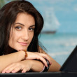 Beautiful woman with a laptop  — Stock Photo