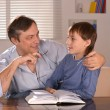 Father and his son sitting on sofa — Stock Photo