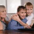 Happy family at a laptop  — Stock Photo