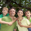 Family in the green jersey — Stock Photo