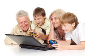 Grandchildren with their superb granddad and granny — Stock Photo