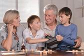 Happy family at a lotto — Stock fotografie