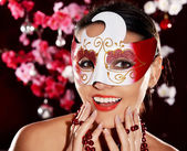 Cute girl in a mask — Stock Photo