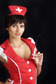 Pretty woman dressed as a nurse — Stock Photo