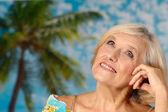 Elderly woman smiling — Stock Photo