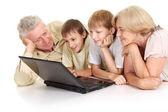 Grandchildren with their favorite grandparents — Stock Photo