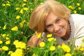 Great lady enjoys union with nature — Stock Photo