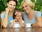 Beautiful family sitting on the veranda — Stock Photo
