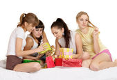 Girl with gifts on bed — Stock Photo