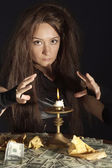 Charming brunette as a witch — Stock Photo