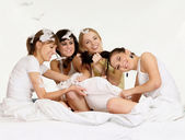 Four beautiful girls indulge — Stock Photo