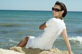 Resting female enjoying the sea breeze — Stock Photo
