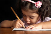 Young girl draws — Stock Photo