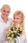 Woman in a white dress with man — Stock Photo