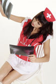 Chica linda vestida como enfermera — Foto de Stock