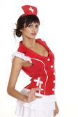 Glad lady dressed as a nurse — Stock Photo