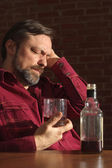 Regretful man at home — Stock Photo