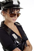 Cool brunette in a suit of police — Stock Photo